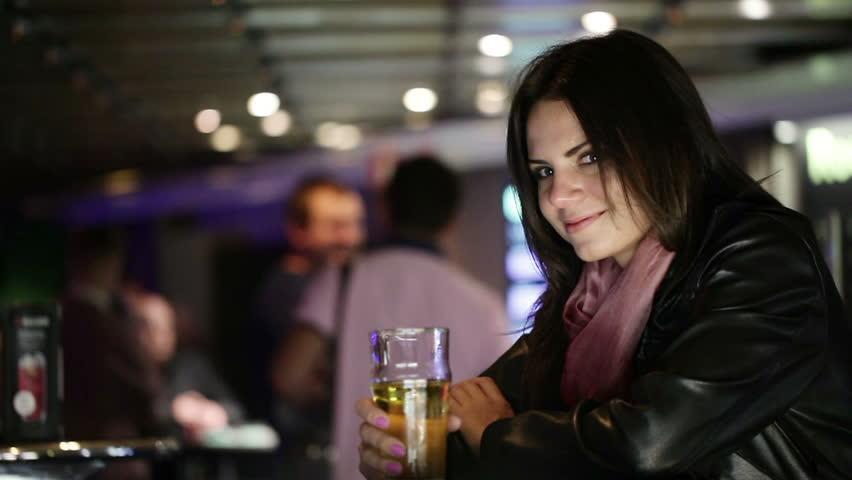 Nightclub girl drinking beer and flirting - HD stock footage clip