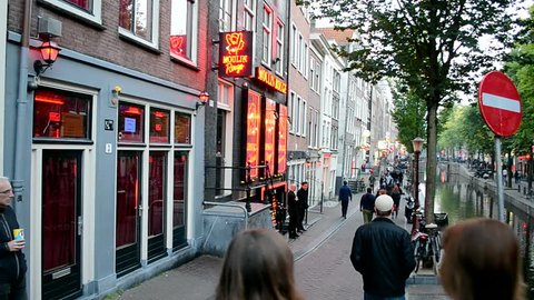 AMSTERDAM - SEP 10: Red Light District on September 10, 2014 in Amsterdam, Netherlands. There are near 500 red windows in the city rented by prostitutes and about 1000 working girls.