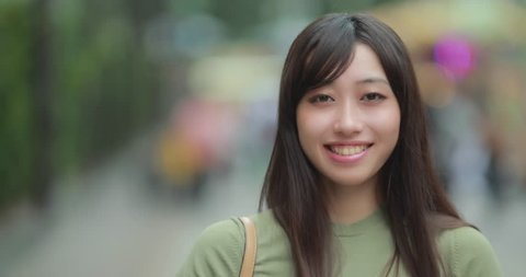 Young Asian Woman in city smile face portrait