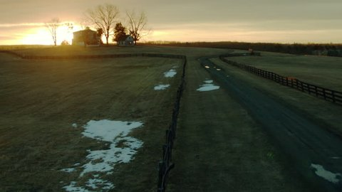 Aerial establishing shot of a farm property in Virginia at sunrise 1080p Stock Video clip.