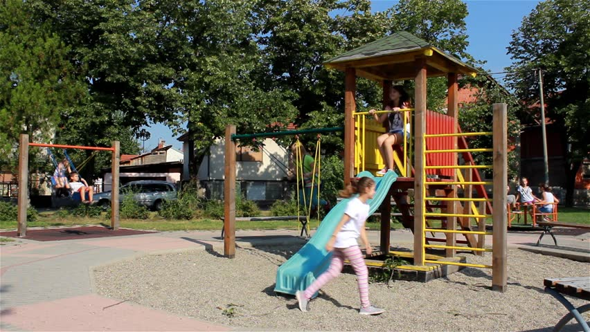 Young Girls Going Down On The Slide Swinging A Swing Spin Merry Go Round Kids Game Teens Playing Playground Childhood Socializing