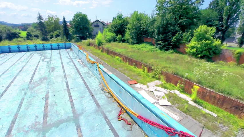ljubljana slovenia august 2014 panning over abandoned olympic swimming pool from air old unused pool complex bankrupt empty pools and overgrown with - Olympic Swimming Pool 2014