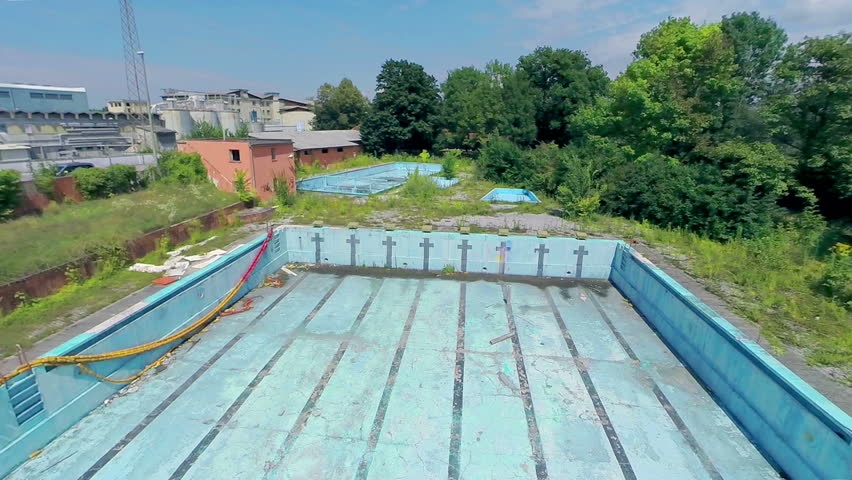 LJUBLJANA, SLOVENIA   AUGUST 2014: Flying In To Abandoned And Empty Olympic  Swimming Pool