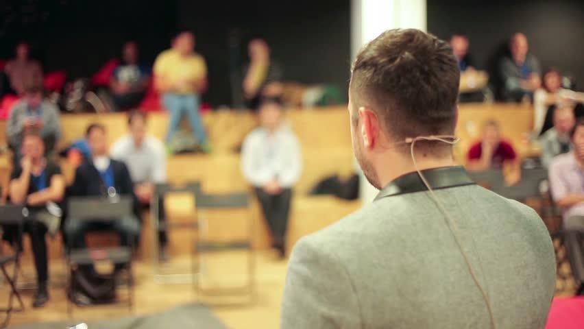 Caucasian speaker teaching at international conference | Shutterstock HD Video #7377823