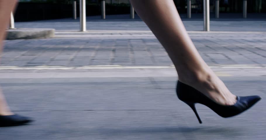Sexy legs black high heels walking in city urban street - RED EPIC DRAGON 6K #7391881