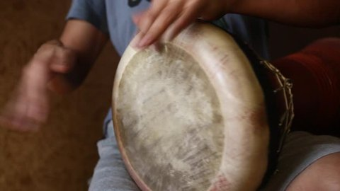 Man is playing eastern drum using turkish split-hand technique/Man Is Playing Darbuka