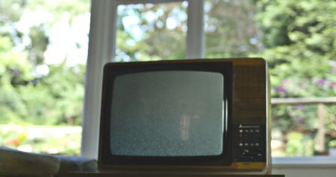 Dolly into vintage television in suburbia. 76 years of television history came to an end at midnight on Wednesday 24 October 2012 when the analogue TV signal was switched off. (UK, July 2014)
