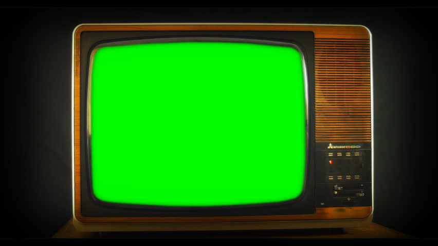 Zoom into vintage Analog TV with green screen. 76 years of television history came to an end at midnight on Wednesday 24 October 2012 when the analogue TV signal was switched off. (UK, July 2014)
