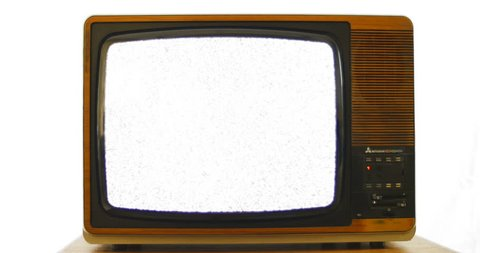 Slow zoom into vintage 1970s television. 76 years of television history came to an end at midnight on Wednesday 24 October 2012 when the analogue TV signal was switched off. (UK, July 2014)