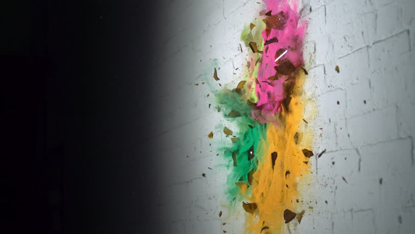 Smashing glass bottle of colorful sand shooting with high speed camera, phantom flex.