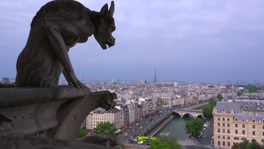 Classic shot of gargoyles watch over Paris, France from Notre Dame cathedral.