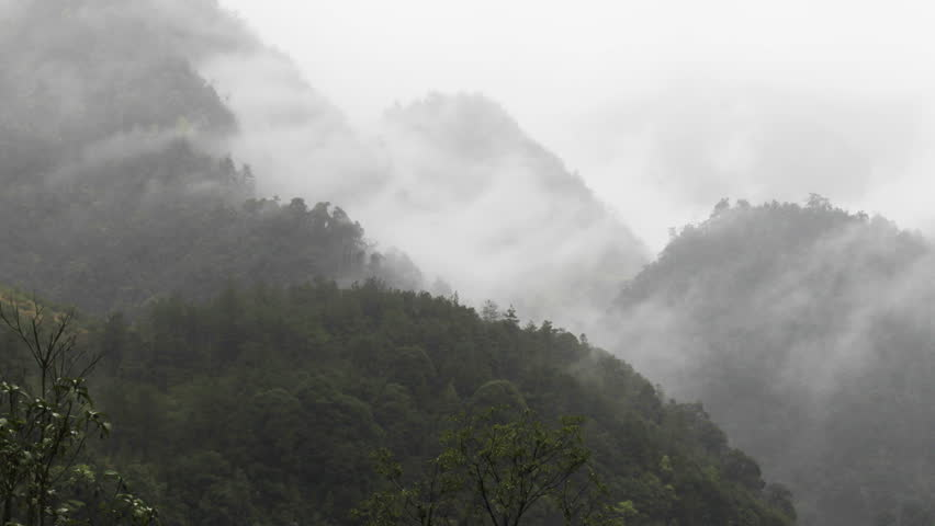 Time lapse of clouds crossing over mountain in the rain.  | Shutterstock HD Video #756241