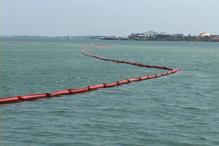 Oil booms designed and anchored in the water to hold back floating spills, protect the shoreline in the inter coastal waterways of coastal southern Alabama from an oil disaster.