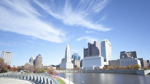 COLUMBUS, USA - NOV 9, 2011: 4K Time lapse zoom out of Columbus skyline and the Scioto River at daytime. Columbus is the capital of Ohio