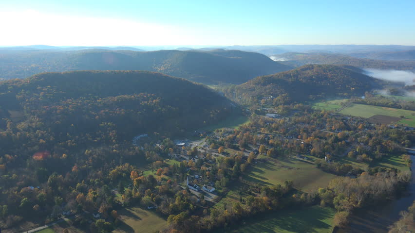 Viewing North up the Housatonic valley, towards the small town of Kent. Fall 4K aerial landscapes. Shot in the NY, Hudson Valley, Conn, Mass border just below The Berkshires.