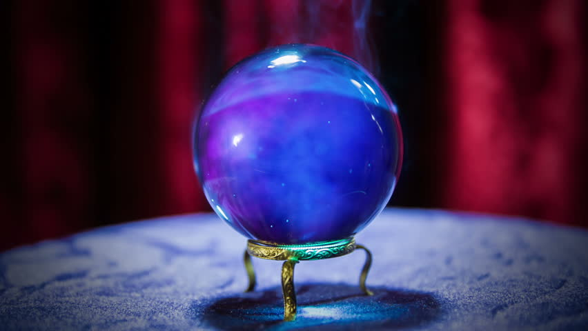 Seamless clip of a magic crystal ball on a table/ Seamless looping clip of fortune teller crystal ball on a table