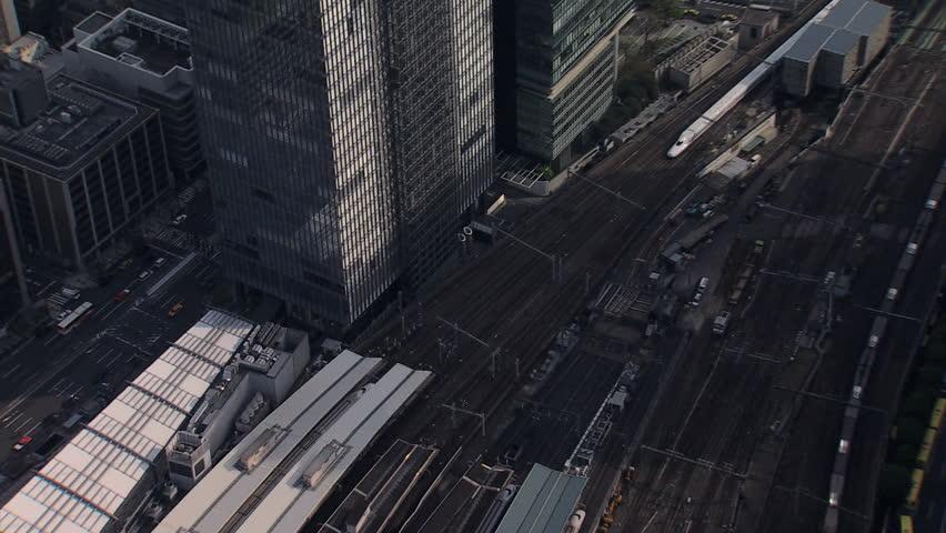 Aerial zoom TGV high speed Shinkansen Aerodynamic train Tokyo Metropolis Rail Station Japanese Railway