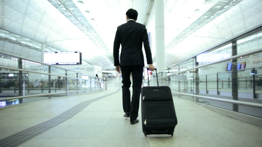 Male Asian Chinese businessman consultant airport departures hall travel destination professional corporate executive meeting | Shutterstock HD Video #7810111