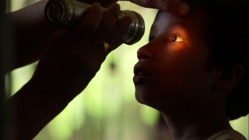 Nepalese child receiving an eye exam,   Shutterstock HD Video #7810123