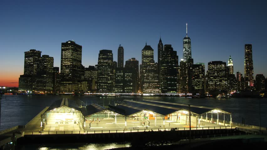 People involved in sports in hangars near the river in the night Manhattan. Time lapse. | Shutterstock HD Video #7831411