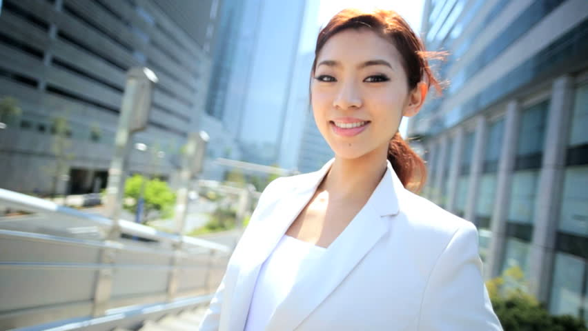 Confident young ethnic Asian Japanese female corporate business manager banking consultant outdoors cityscape background | Shutterstock HD Video #7834510