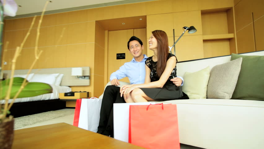 Young male female Asian Chinese heterosexual couple vacation hotel designer bags shopping trip travel pleasure | Shutterstock HD Video #7838611