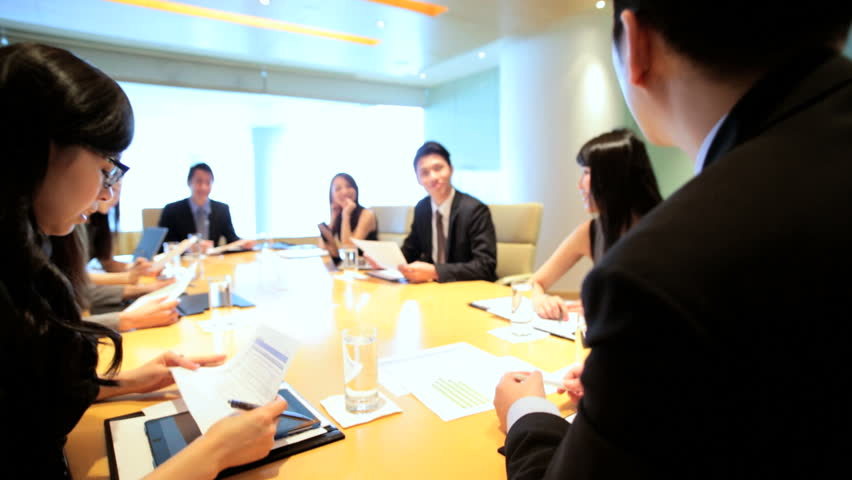 Asian Chinese male female business executives consultants city boardroom meeting teamwork communication conference wireless tablet device | Shutterstock HD Video #7852099