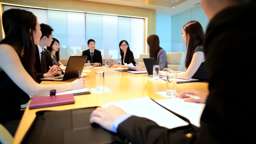 Ethnic Asian Chinese smart businessmen businesswomen corporate management conference meeting wireless laptop device planning | Shutterstock HD Video #7852261