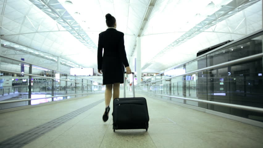 Smart European Caucasian female financial consultant city airport travel meeting conference baggage departure destination corporate business | Shutterstock HD Video #7854451