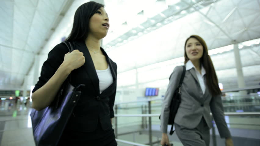 Young Asian Chinese smart suit females business travellers airport terminal atrium conference meeting professional corporate management   Shutterstock HD Video #7854751