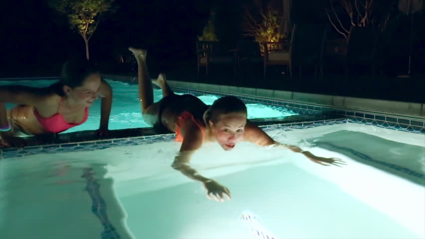 a556c16562836 2 Silly Girls Slide On Their Bellies To Get Into Hot Tub (Camera Dolly Move)