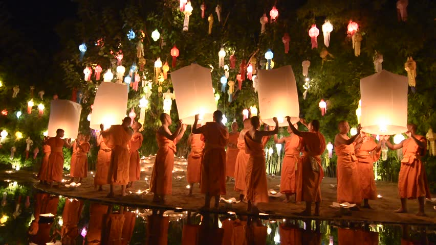 CHIANG MAI THAILAND-NOVEMBER 08 2014:Unidentified monks release floating lamp made of paper annually at Phan Tao temple in Loy Krathong and Yi Peng Festival