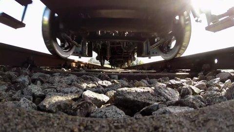 steam train rising over camera. old locomotive. railway tracks background