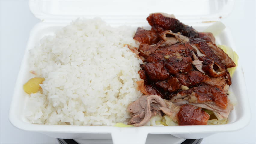 360-degree rotating lunch box of roasted duck.