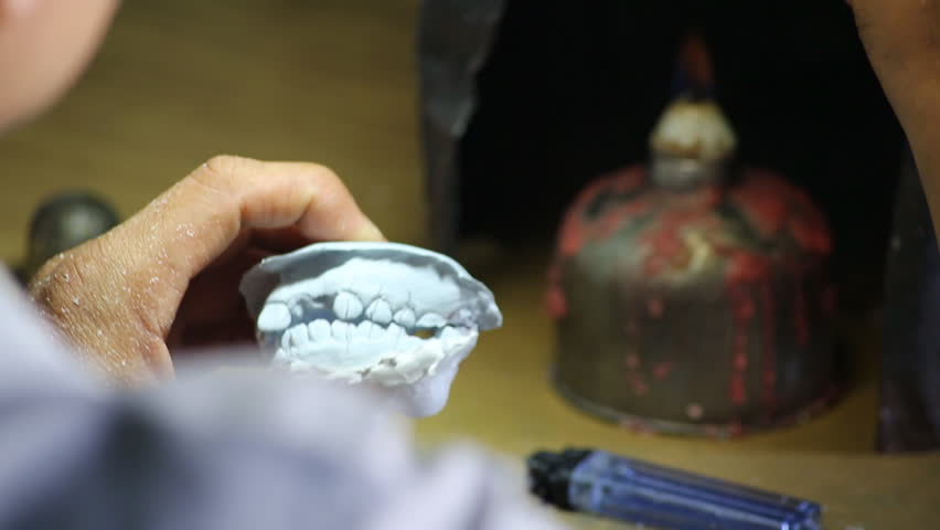 Giving Shape to Tooth in Laboratory for mount,false teeth #7885351