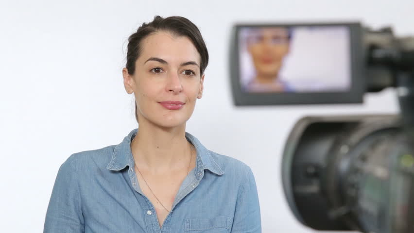 Actress on a production set talking to the camera