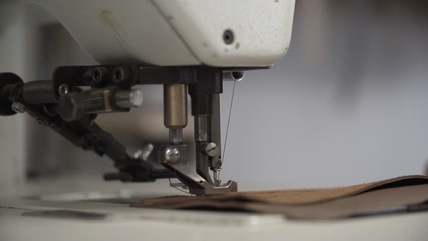Closeup shot of sewing machine in slow motion