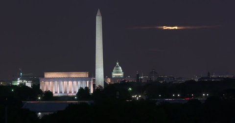 Washington DC Skyline Timelapse at Night With Super Moon, Lincoln Memorial, Washington Monument and US Capitol Building. There is plenty of time before the moon appears to use without the supermoon.