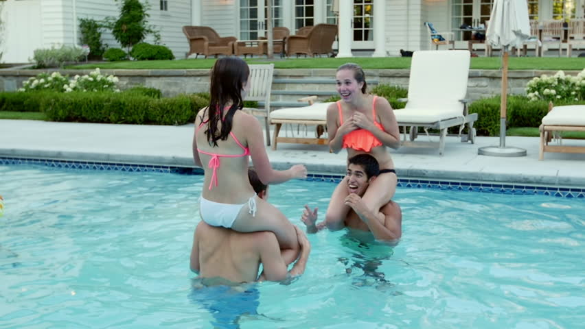 Teen Friends Have A Fun Chicken Fight At A Pool Party -9429
