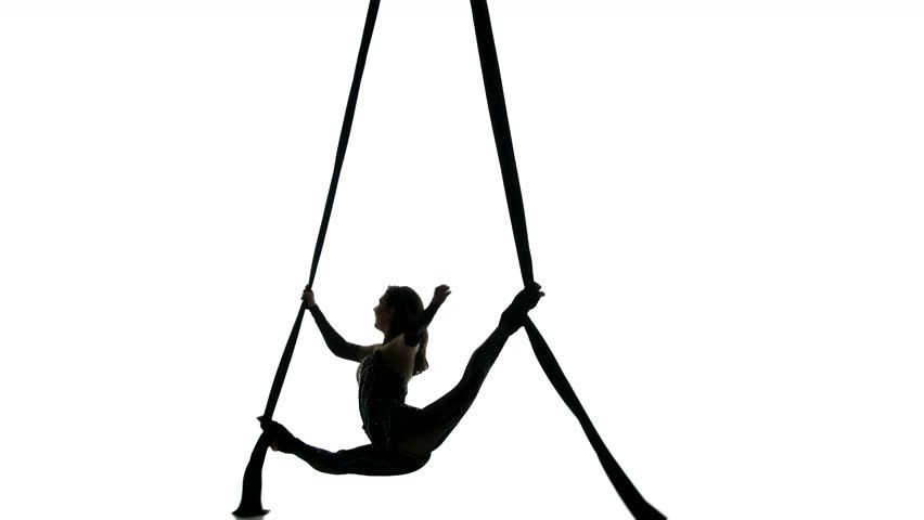 woman dancer on aerial silk aerial contortion aerial ribbons aerial fabric in posing an athlete on a hammock shows tricks in the sky she is an aerial      rh   shutterstock