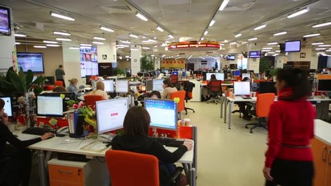 MOSCOW, RUSSIA - MAR 5, 2013: Employees work at tables with computers in office of RIA Novosti russian news agency
