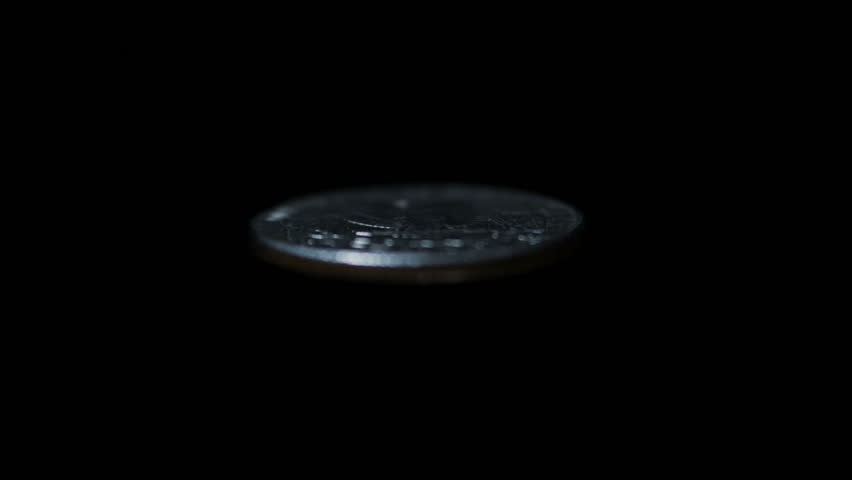 Coin Toss. Quarter flipping in slow motion