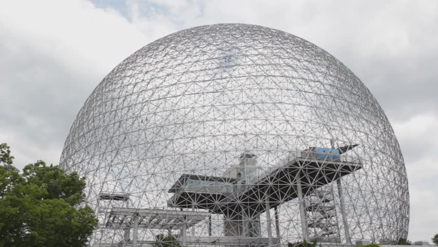 "Geodesic dome. Designed by Richard Buckminster Fuller, the ""Biosphere"" was built for Expo 67 in Montreal, Quebec, Canada. Breeze in the trees and spinning windmill inside the dome.  