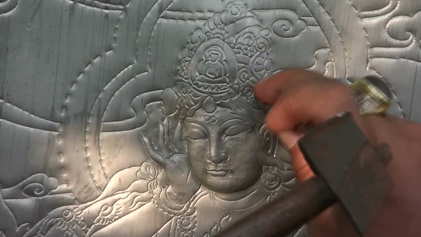 Thai sculptor makes traditional Buddhist art.