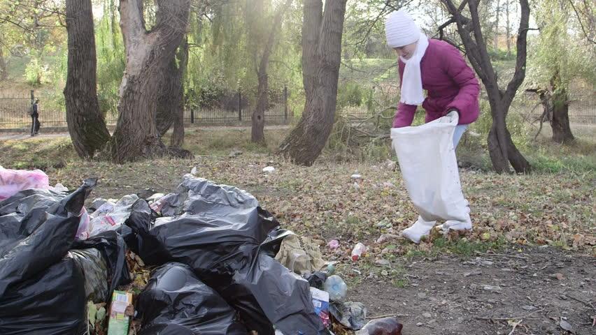 Volunteer Helps Clean up Trash Stock Footage Video (100% Royalty-free)  7967731 | Shutterstock
