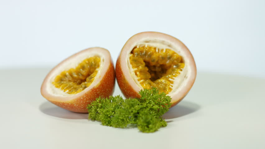 Nice shot of passion fruit over a white backdrop