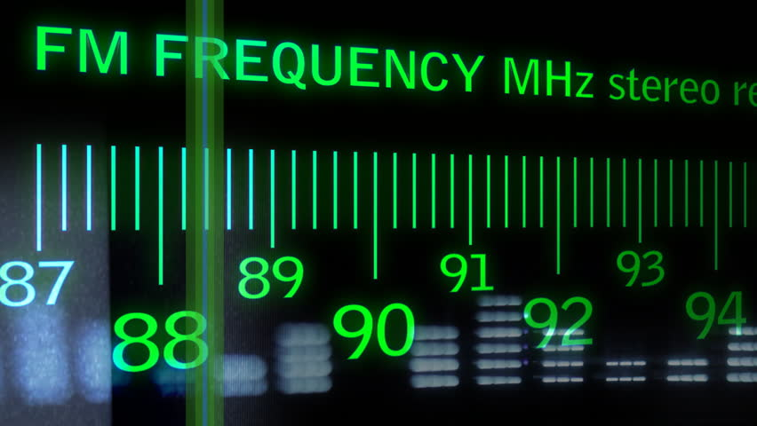 motion graphics an analogue radio dial tuning in different radio frequencies