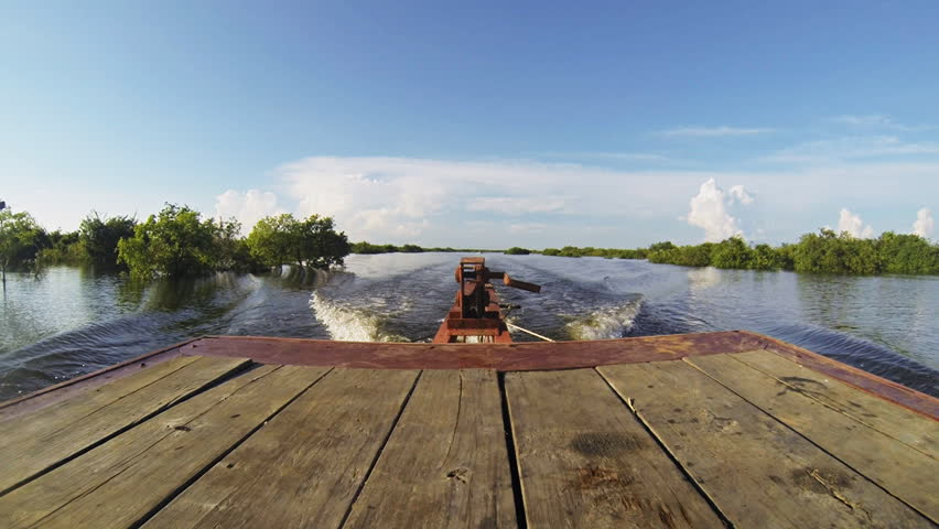 Rear view from a boat on its way to Tonle Sap in Cambodia. Filmed at 60fps