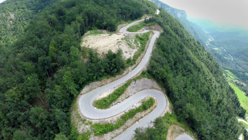Wide angle aerial shoot of pass road. Wide angle aerial shoot of pass mountain road for adrenalin and dangerous long board competition