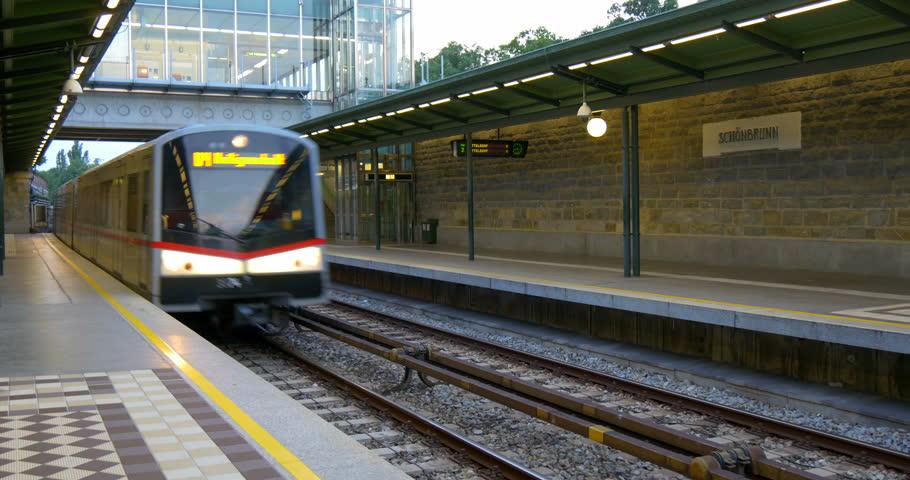 Public subway or metro train arriving Schonbrunn U-bahn (modern underground railroad transportation system in Wien) railway station platform in Vienna city, Austria